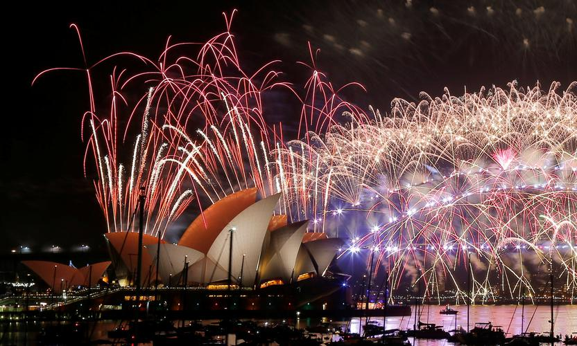 Fireworks explode over the Sydney Opera House and Harbour Bridge as Australia ushers in the New Year in Sydney.