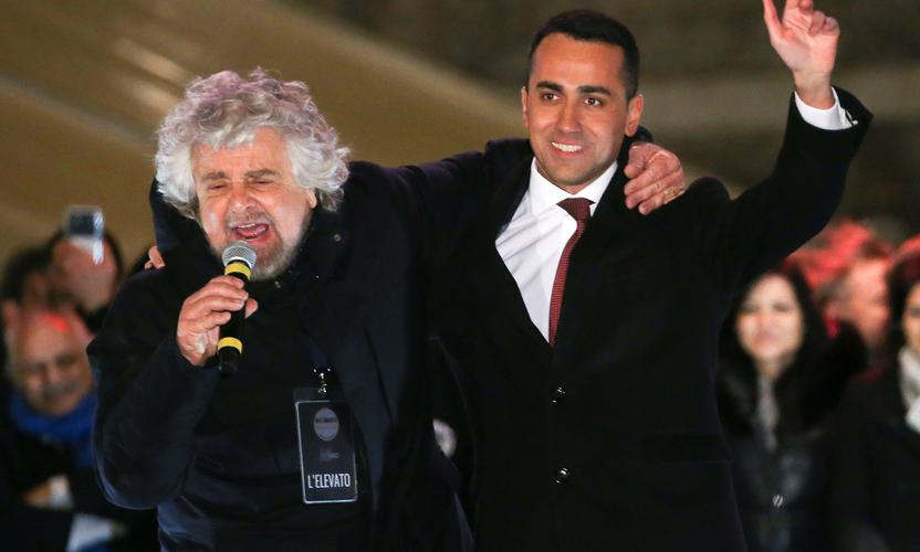 5-Star Movement founder Beppe Grillo (L) speaks next leader Luigi Di Maio in Rome during their finally rally ahead of the Italian election.