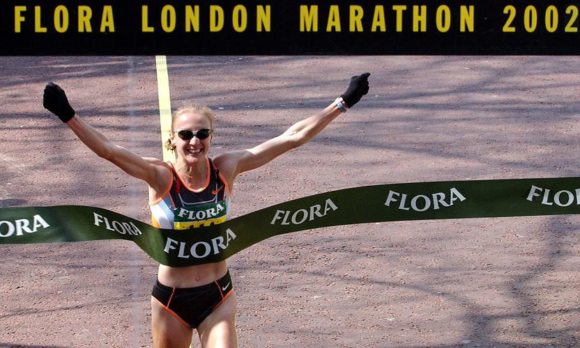 Britain's Paula Radcliffe crosses the finish line of the 22nd annual LondonMarathon, April 14, 2002. Radcliffe produced one of the best ever runningperformances winning the women's race in 2 hours, 18 minutes and 56 seconds.PP03040044  REUTERS/Stephen HirdSH/NMB/WS