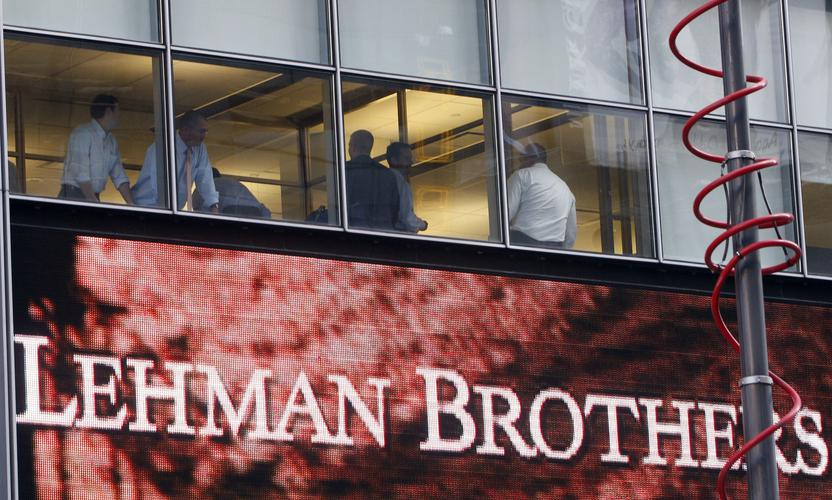 People look out of the window at the Lehman Brothers Holdings Inc building in New York September 15, 2008. Lehman Brothers Holdings Inc filed for bankruptcy after trying to finance too many risky assets with too little capital, becoming the largest and highest-profile casualty of the global credit crisis. Based on assets, Lehman far surpassed WorldCom as the largest U.S. bankruptcy ever. Lehman had assets of $639 billion at the end of May, while WorldCom had $107 billion when it filed for bankruptcy protection in 2002. REUTERS/Joshua Lott (UNITED STATES)