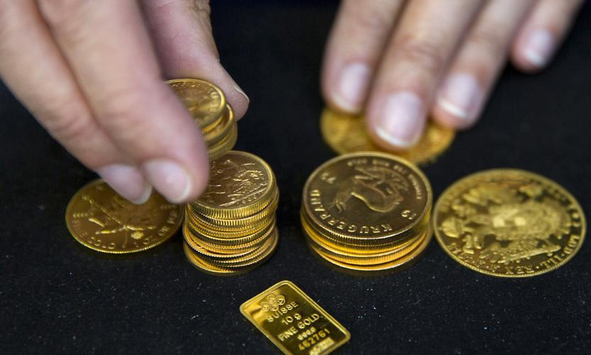 Gold bullion on display at a precious metals dealer in London. REUTERS/Neil Hall
