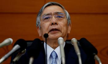 Bank of Japan holds fire ahead of sales tax increase, but strikes a more dovish tone