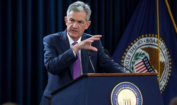 Fed cuts again but stays mute on future path