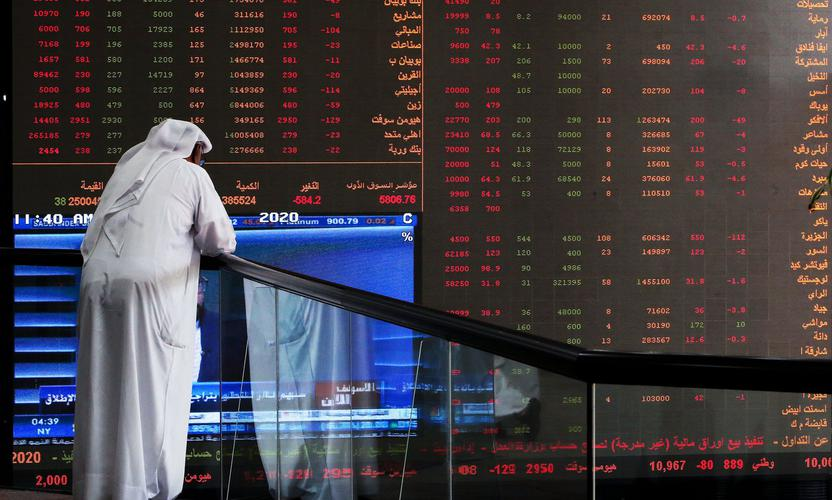 A Kuwaiti trader checks stock prices at Boursa Kuwait in Kuwait City, on March 8, 2020. - Kuwait Boursa authorities stopped trading after the Premier Index slumped 10 percent while the All-Shares index dived 8.4 percent, as shares in the energy-dependent Gulf plunged to multi-year lows after OPEC's failure to agree on a coronavirus action plan prompted fears of an all-out oil price war. (Photo by YASSER AL-ZAYYAT / AFP) (Photo by YASSER AL-ZAYYAT/AFP via Getty Images)